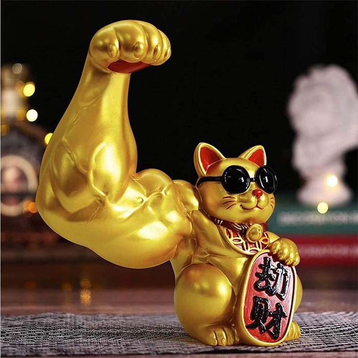 jacked waving cat statue giant paw
