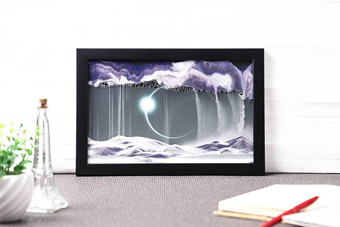 moving sand art solar eclipse background