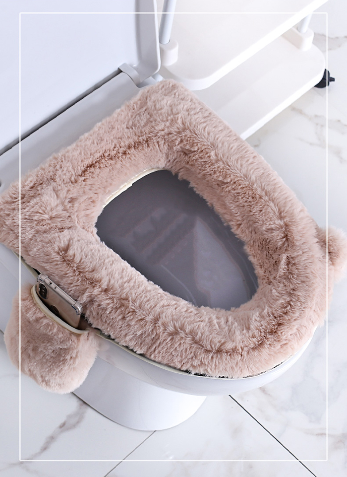 oval fluffy toilet seat cover with phone holder