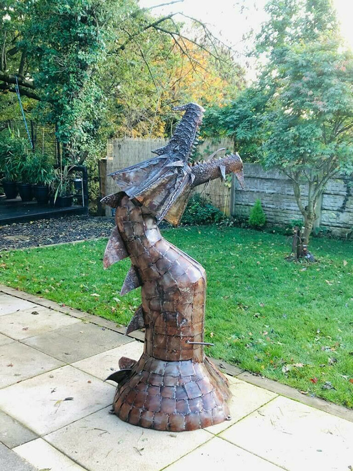 fire breathing mythical creature statue
