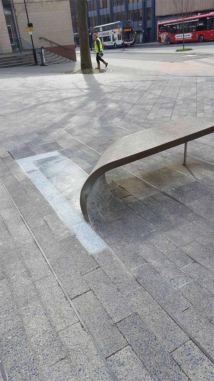 brilliant designs curled up paving stone bench