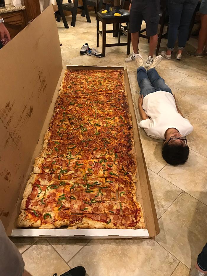 comparison images large pizza vs human