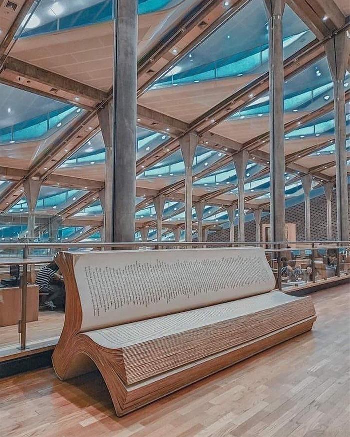 library of alexandria book bench