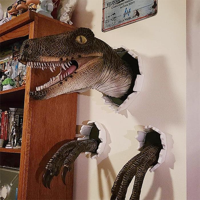 wall bursting dinosaur brown velociraptor