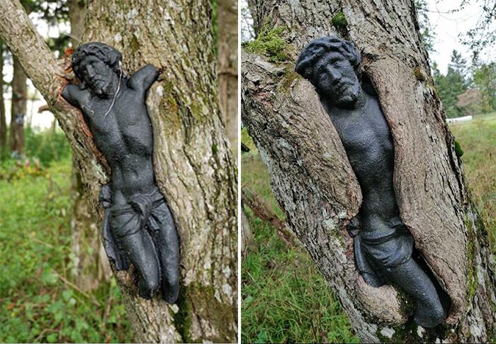 worn down jesus statue tree