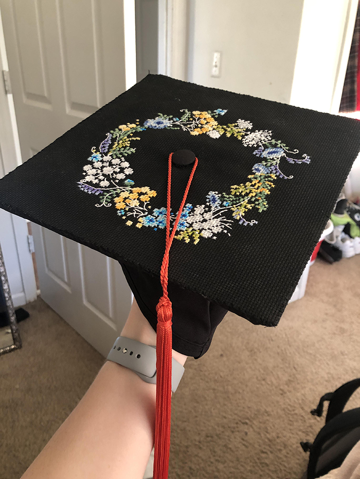 counted-thread embroidery art floral wreath on graduation hat