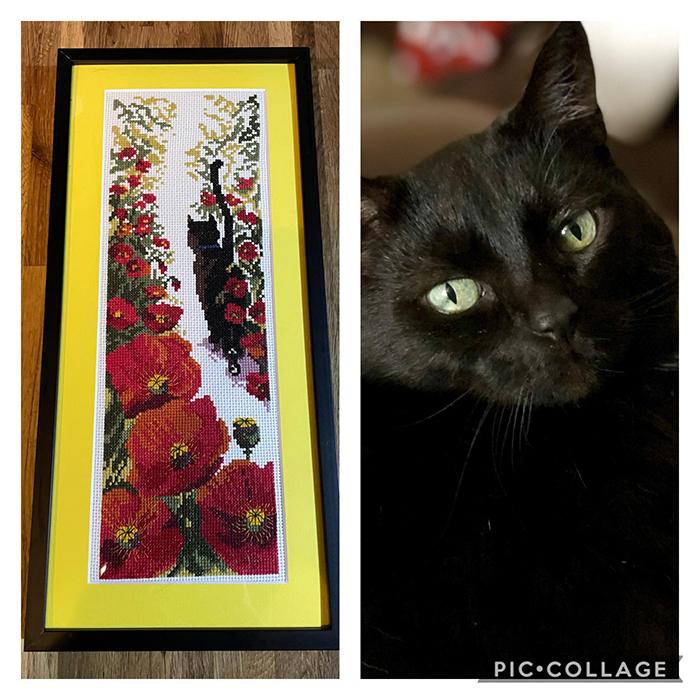 cross-stitch art black cat in garden