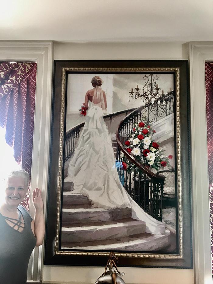 cross-stitch art bride standing on stairs