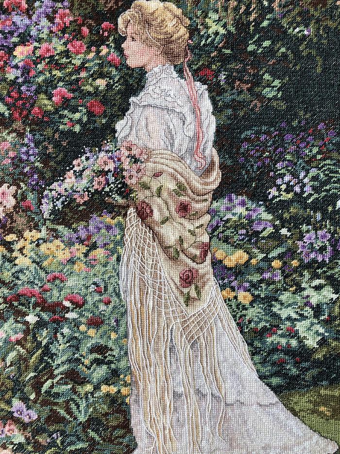 cross-stitch art lady in garden