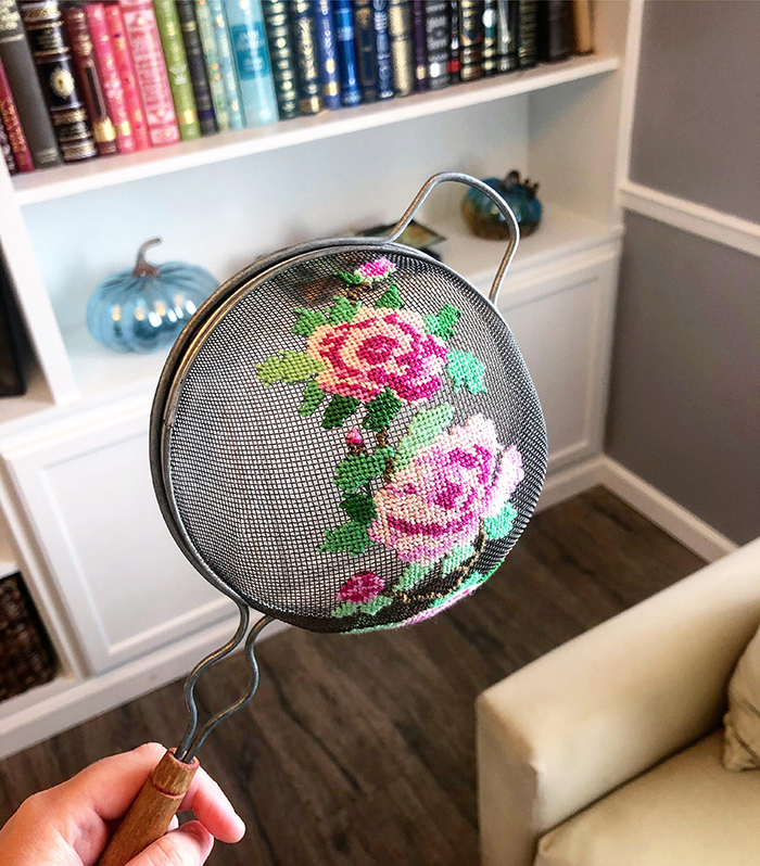 cross-stitch art pink roses on old strainer