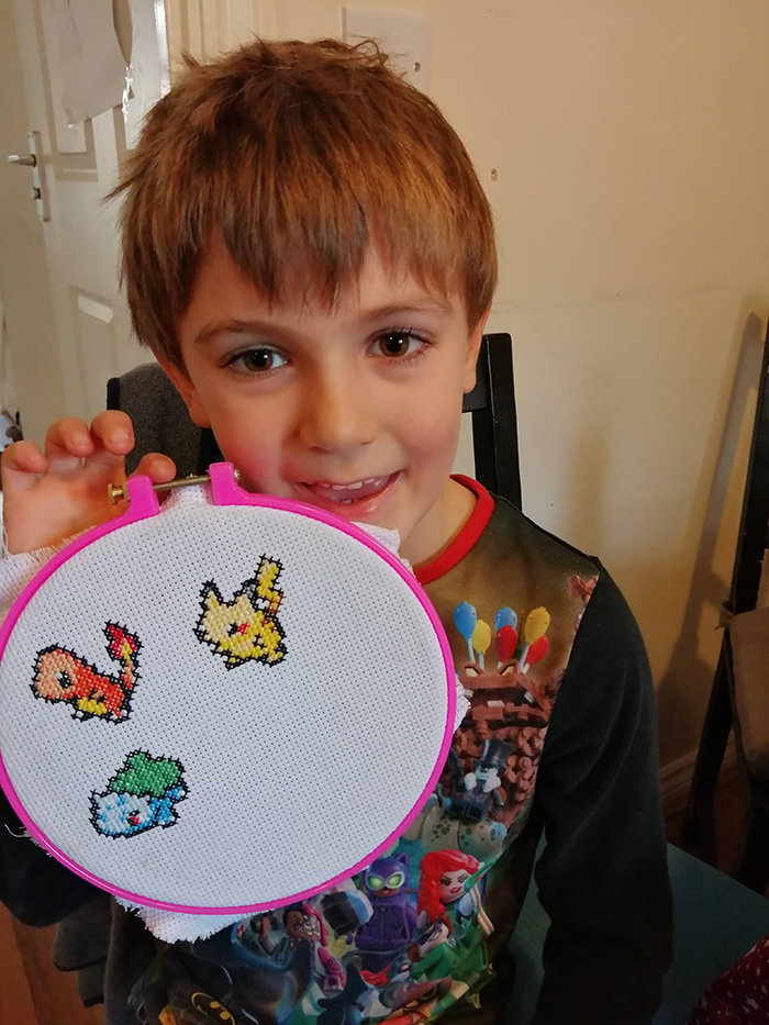 cross-stitch art pokemon by six-year-old boy