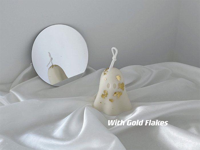 cute halloween candle with gold flakes