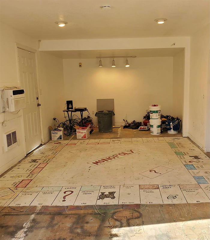 giant monopoly board painted onto floor old house