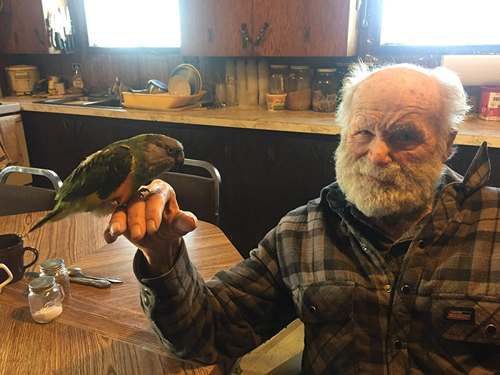 grandfather holding a parrot