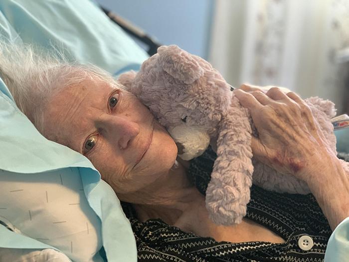 grandmother hugging teddy bear