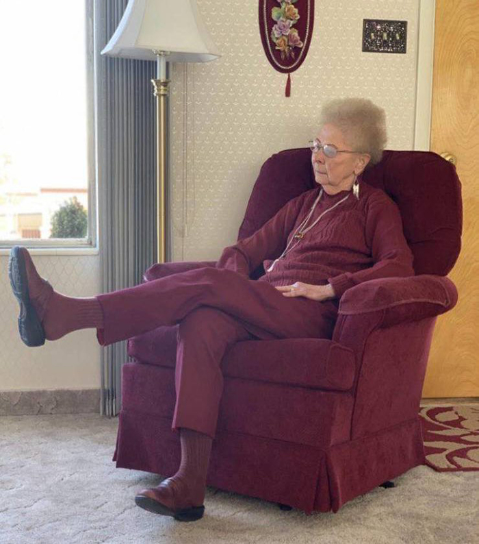 grandmother wearing matching color with her chair