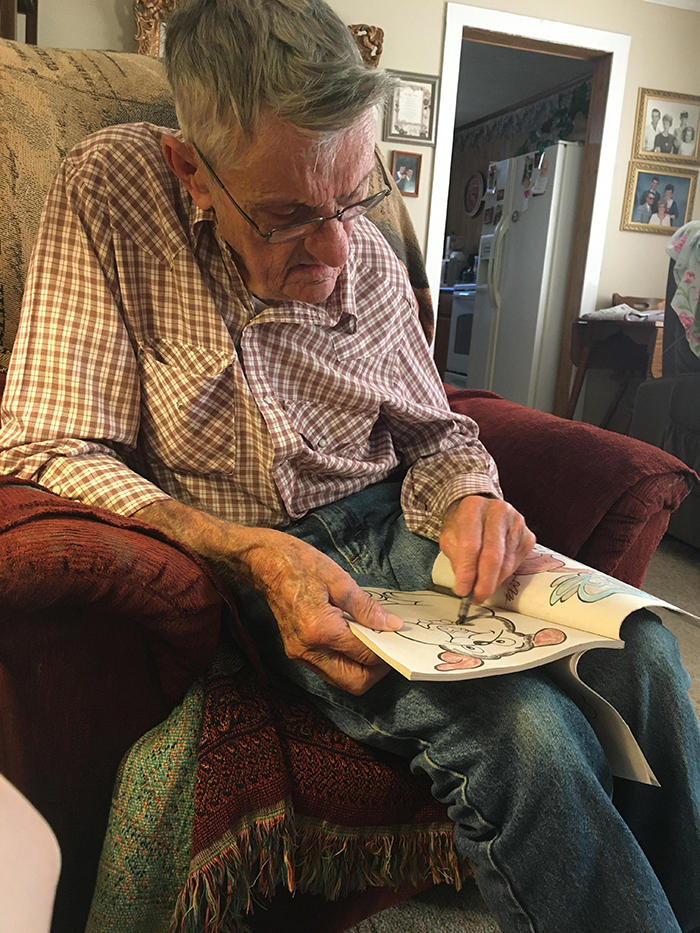 old people being wholesome grandfather working on coloring book page