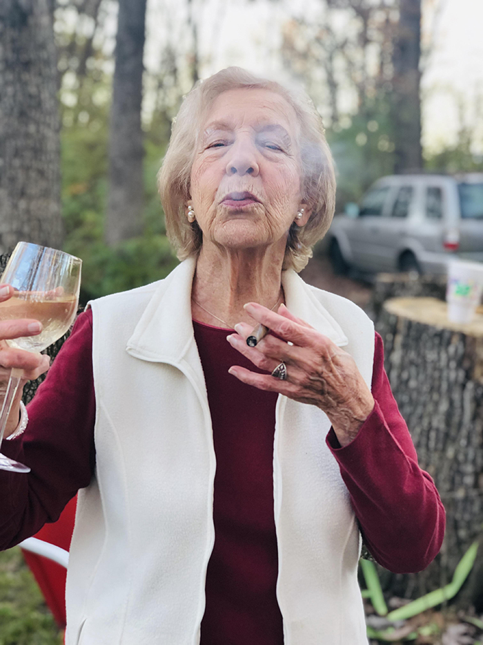 old people being wholesome grandmother smoking cigar and drinking wine
