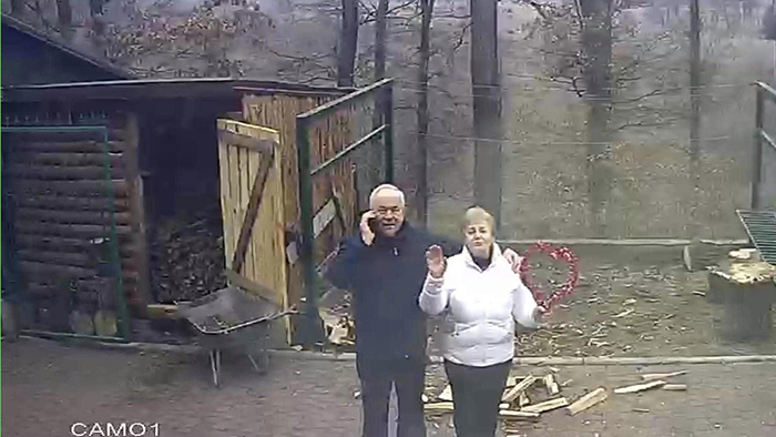 old people being wholesome grandparents waving at security camera