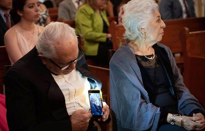 old people being wholesome man taking photo of wife
