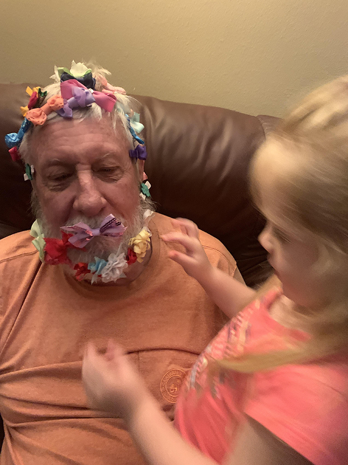 old people being wholesome retired air force colonel playing with granddaughter