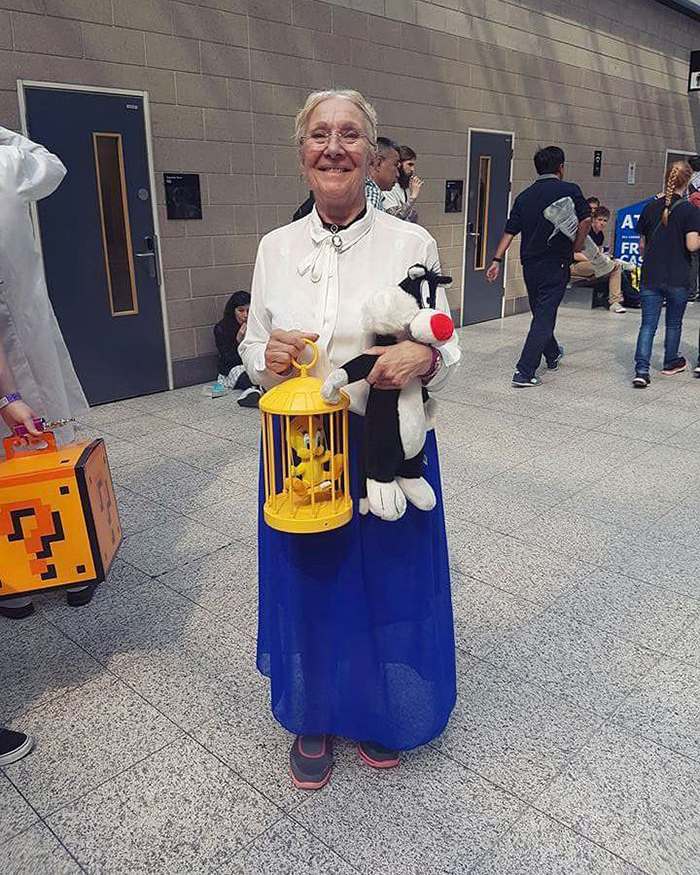 old people being wholesome woman in looney tunes granny costume