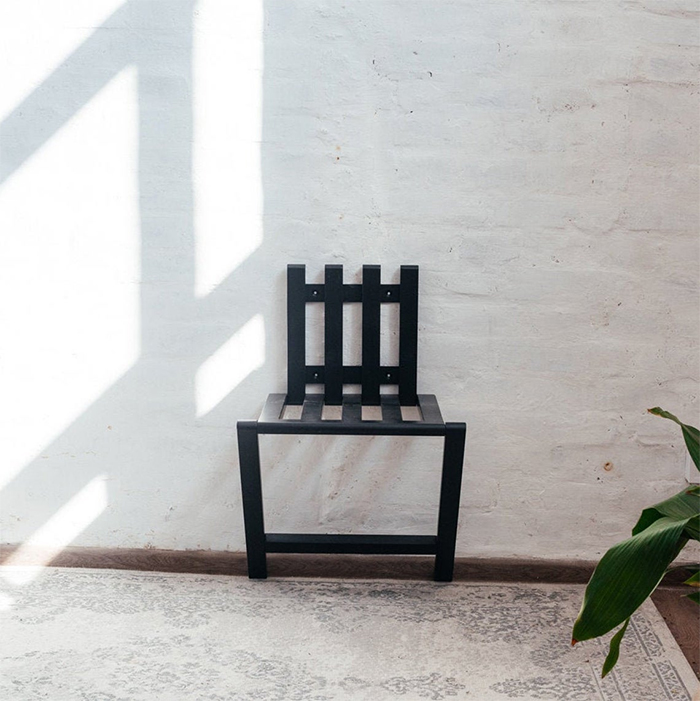 space saving foldable seat black finish