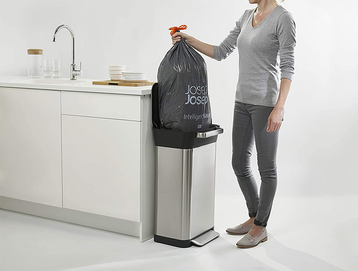 trash compactor bin patented compaction system