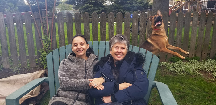 dorky pup photobombing owner and mother