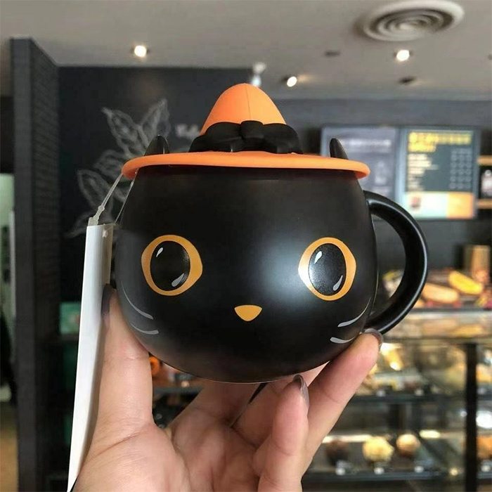 halloween-themed cup with witch hat