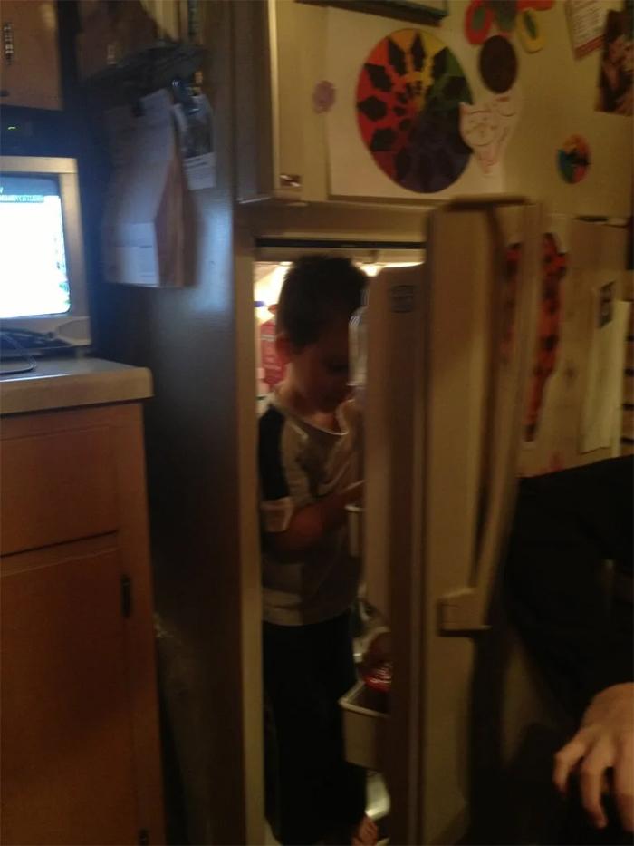 kid inside fridge hot day