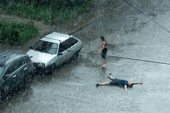 people enjoying the rain summer