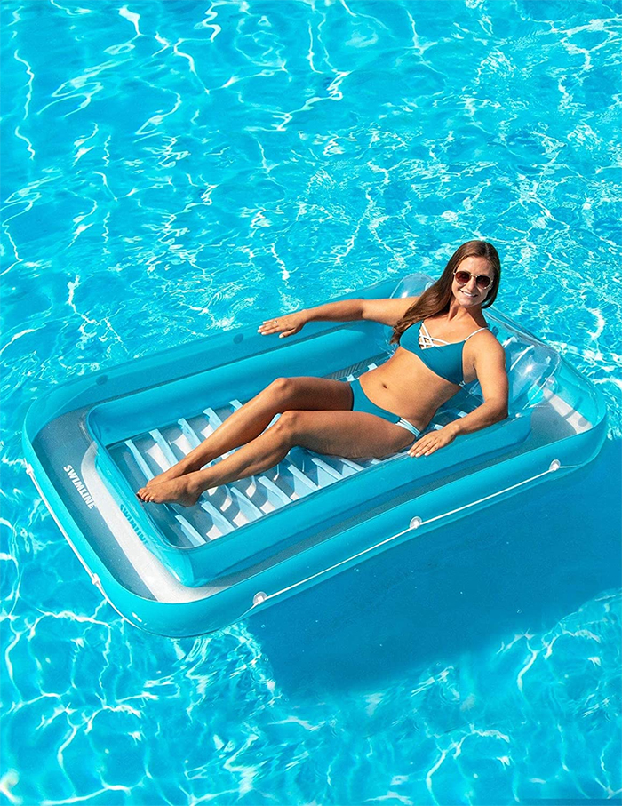 pool float with ribbed base construction and headrest