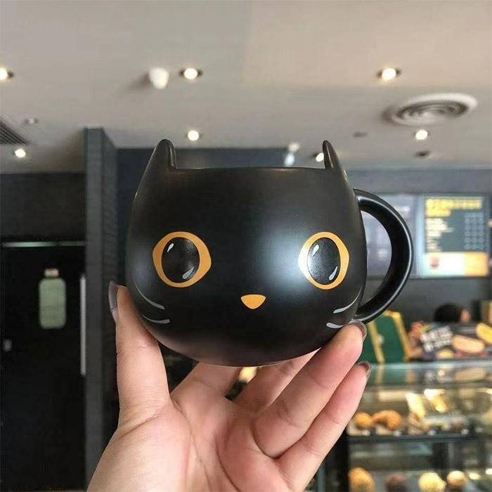 starbucks black cat mug orange details
