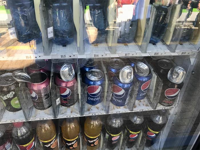 summer heatwaves canned soda exploding inside vending machines