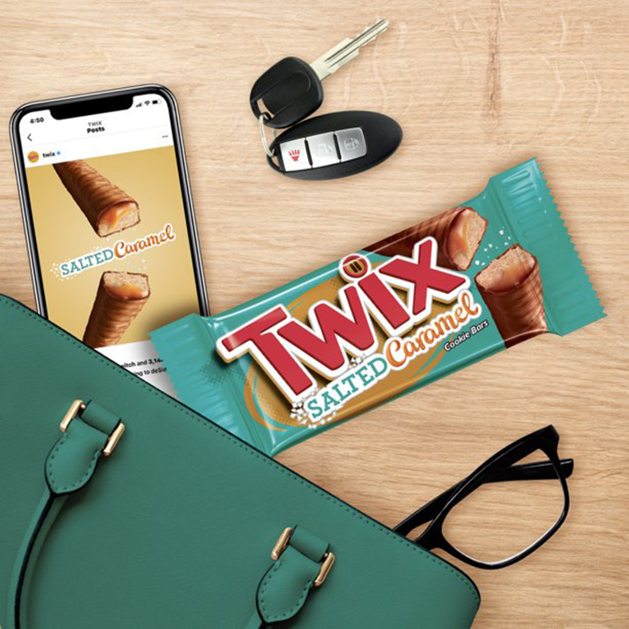 bag content flatlay with candy bar