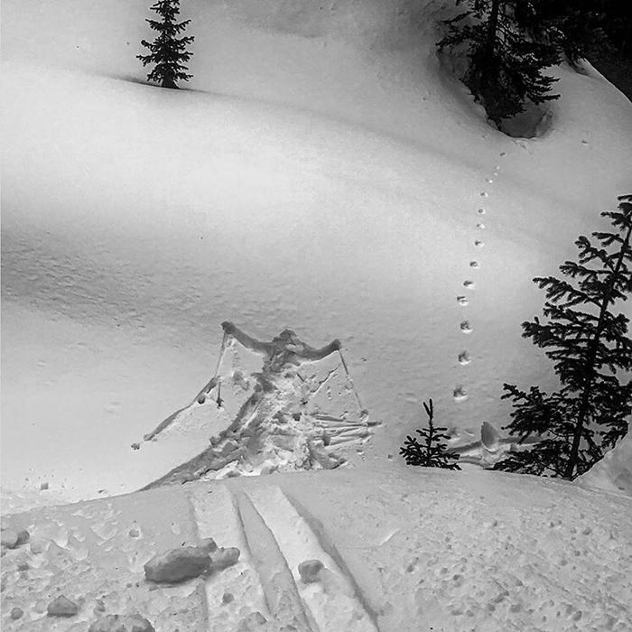 skier body print on snow