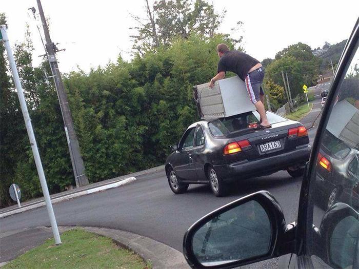 strange things holding fridge on top car