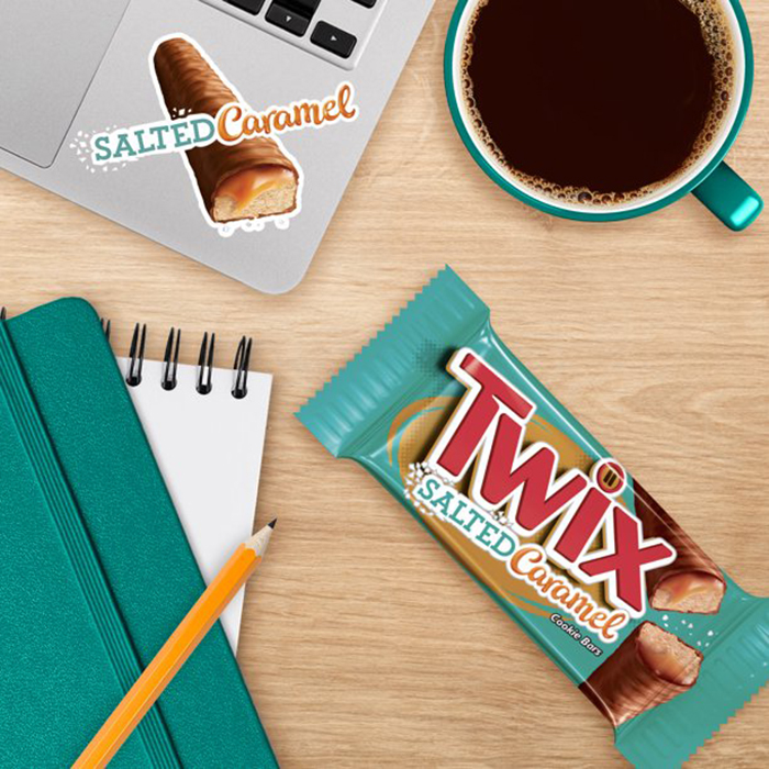 work desk flatlay with candy bar