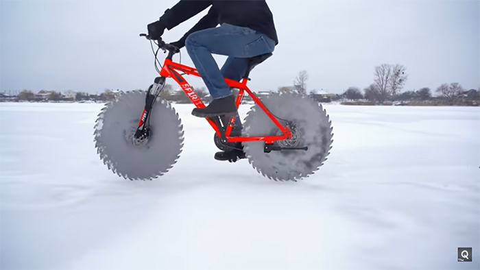 bicycle with saw blade tires cycling on ice